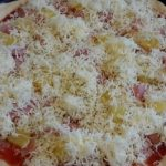 Pizza topped and ready to bake