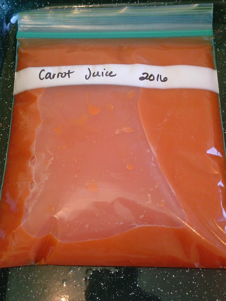 Carrot juice, in a thin layer, in baggies.