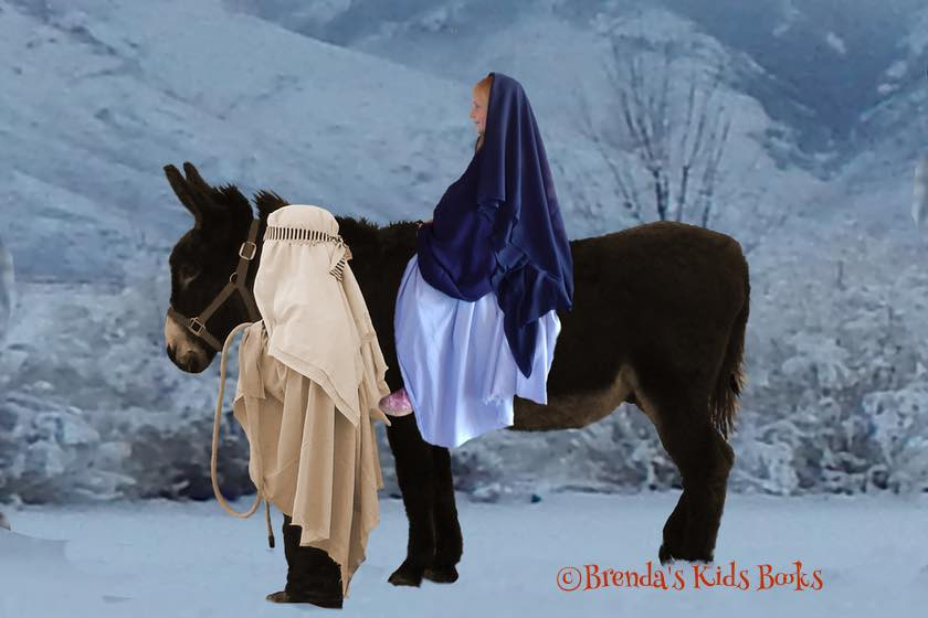 Joseph leading Mary in on Gus our donkey.