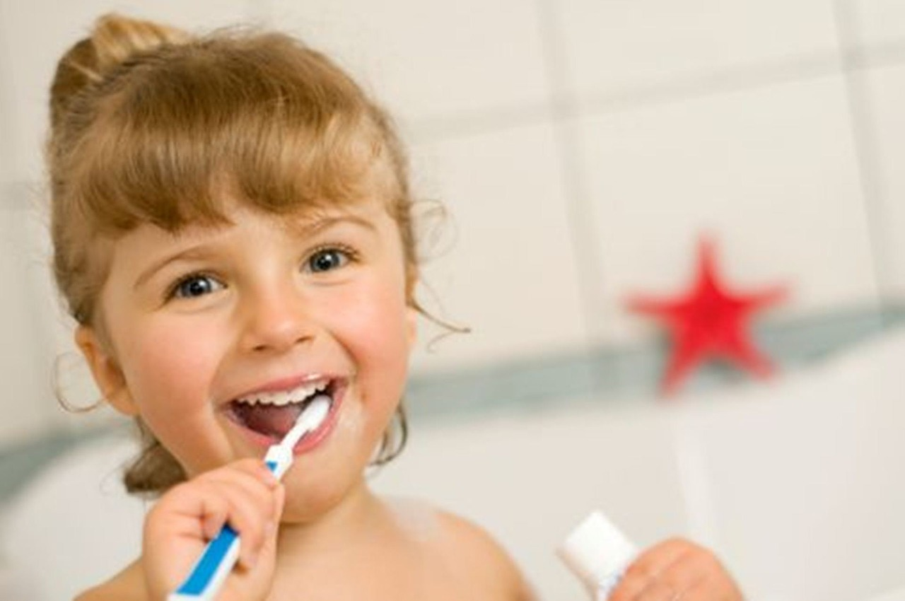 Little girl brushing her teeth